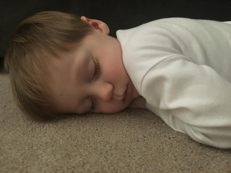 Wouldn't nap in his bed...fell asleep on the floor in our room instead.