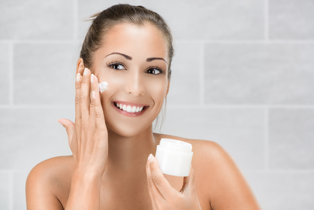 Typical Stock - No one ever looks this happy applying face cream.