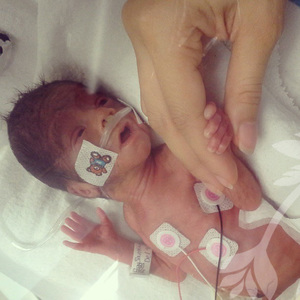 Precious baby Josiah, perfectly designed looking at his mommy for the first time