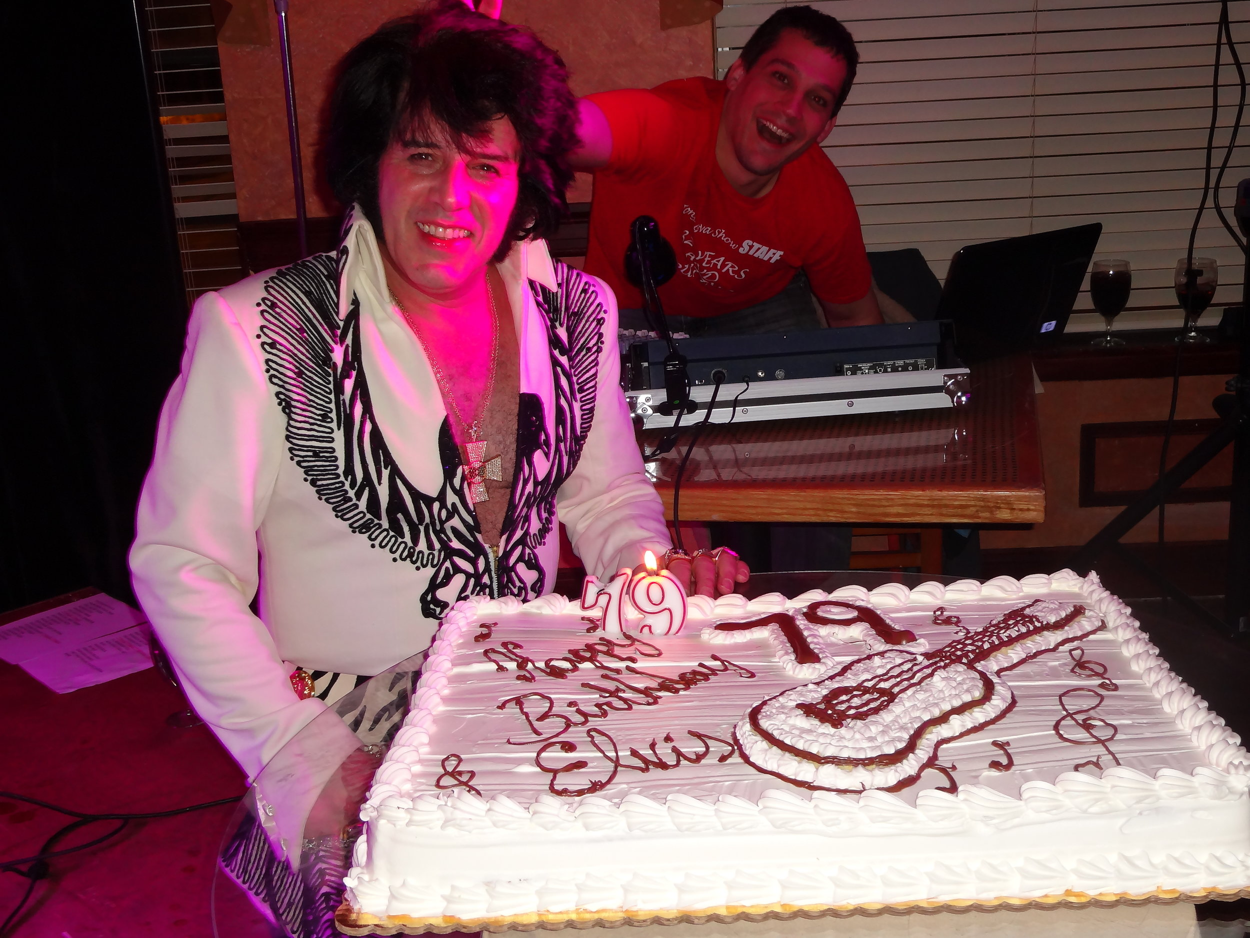 Tony & Josh in background on lights & sound during show blowing out candle for Elvis' 79th birthday show!