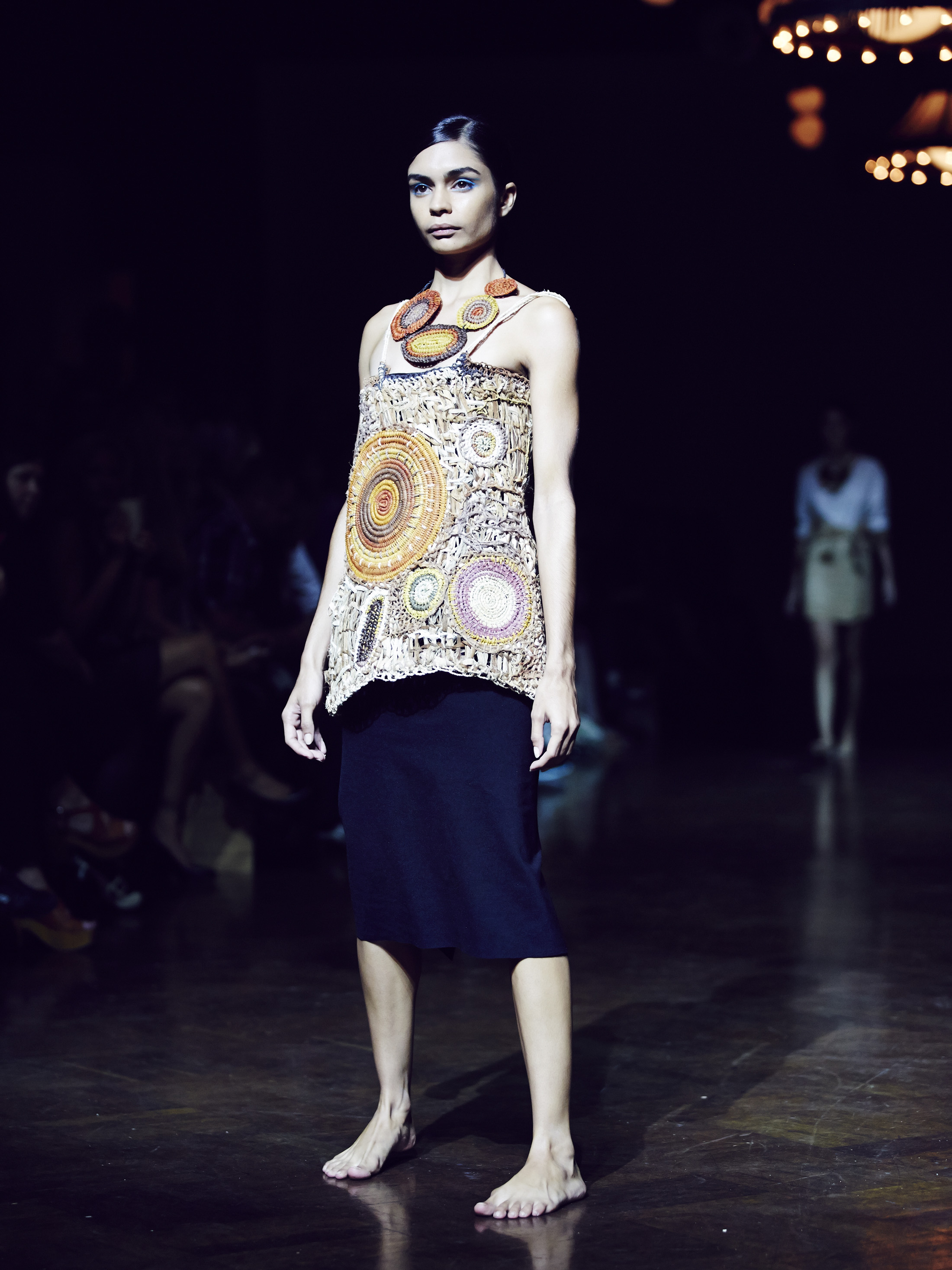 Mavis Ganambarr's Pandanas Tunic and Necklace on the runway at AIFW 2014. Photo Hamish Gregory.