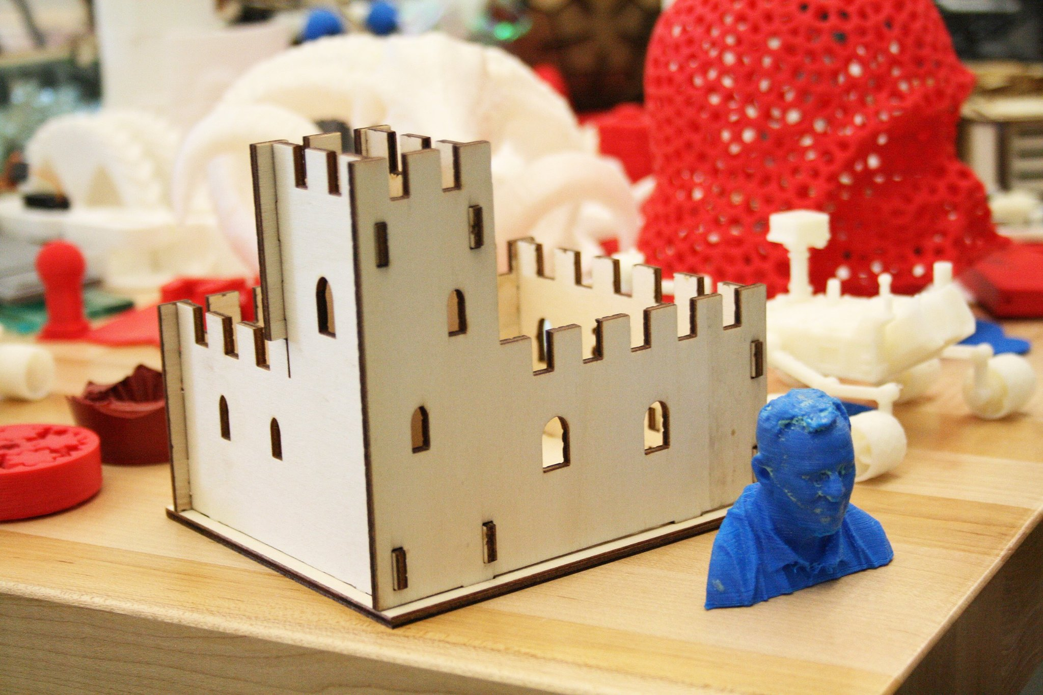 Laser cut castle and 3D printed busts.