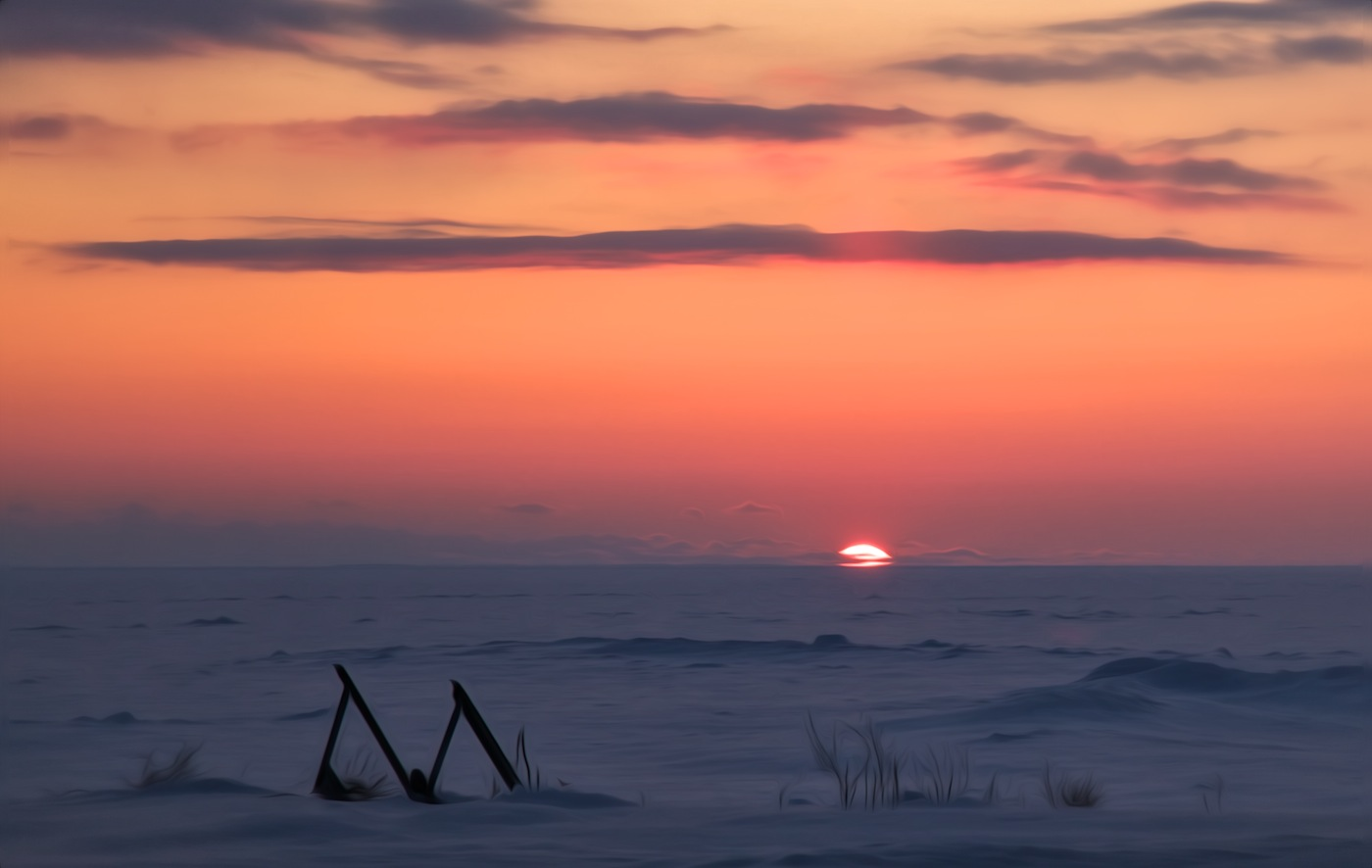 The sun goes down over Lake Ontario on February 15, 2014