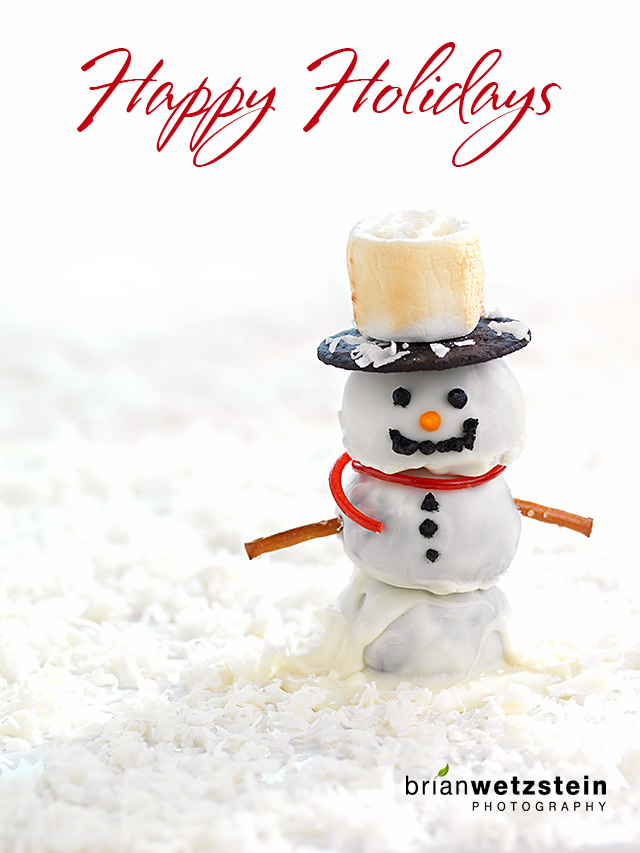 The snowman is made up of Coconut Rum Balls, dipped in White Chocolate..