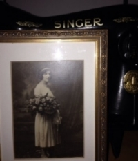 Mary Adorno Velleca, at her sister's wedding, circa 1921, and her old Singer