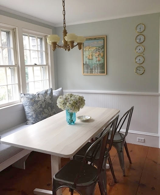 This cozy beach house kitchen banquette is the perfect place for morning coffee, Orleans, MA.
