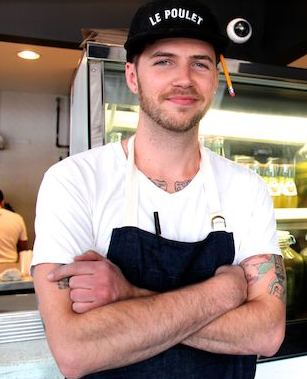 Chef Seiger Bayer, wearing an eco denim apron and branded hat