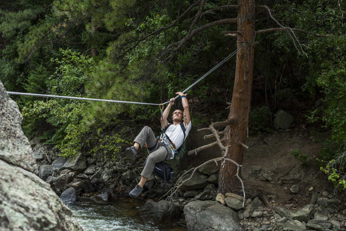Brady Cervetti crossing the tyrolean traverse.
