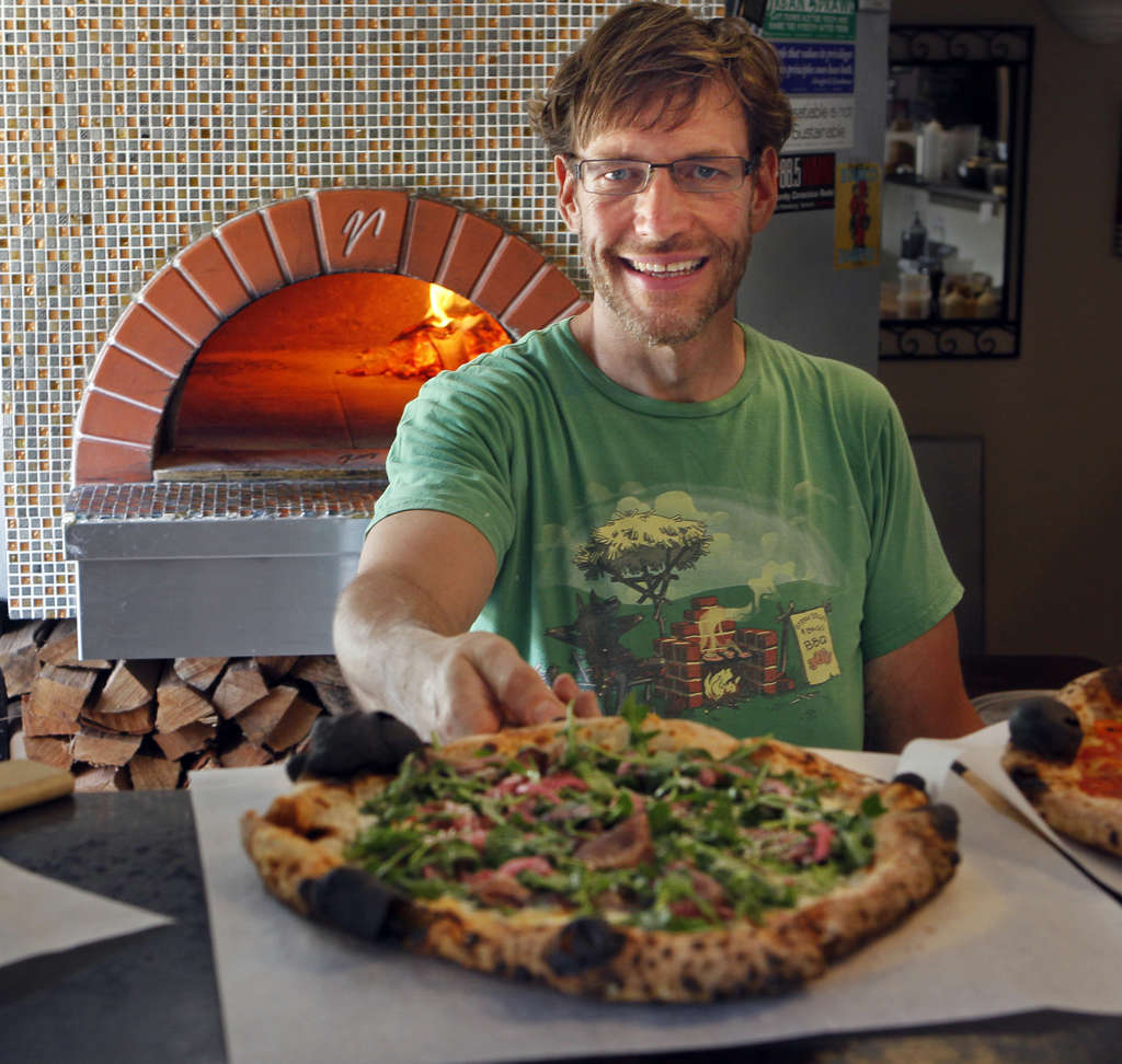 Chef Greg Seymour at Pizzeria Gregario sources local products and makes many items from scratch. The Lombardy pizza features local buffalo milk and fontina cheeses with house-cured bresaola (beef), pickled Florida onions, garlic and arugula. (JIM DAMASKE | Times)