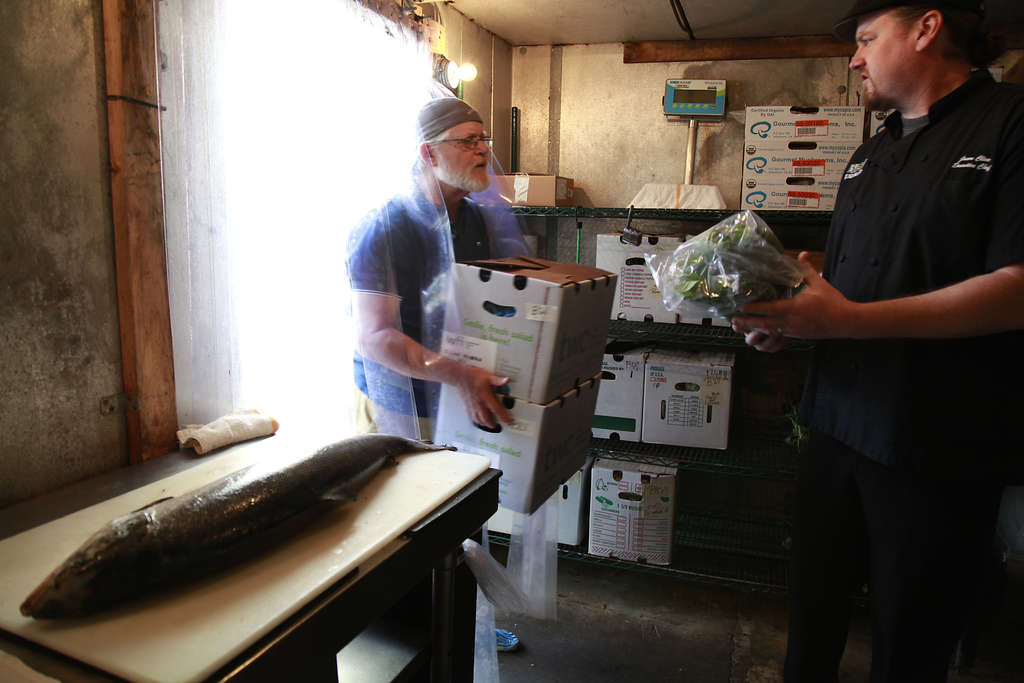 John Matthews, left, owns Suncoast Food Alliance, which provides local farm goods to chefs like Jason Cline, right, of The Birchwood in St. Petersburg. (LARA CERRI | Times)