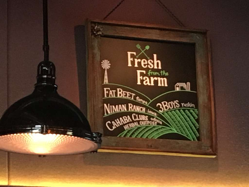 Noble Crust in St. Petersburg showcases some of its purported farm purveyors on a chalkboard. (STEPHANIE HAYES | Times)
