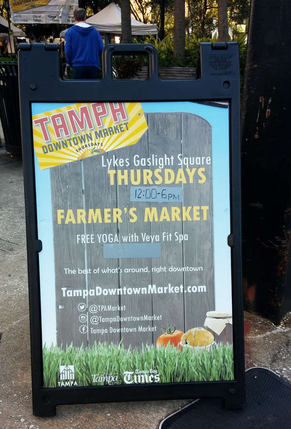 The sign for the Tampa Downtown Market at Lykes Gaslight Square advertises a farmers market, but offers the wares of just a couple farmers. (LAURA REILEY | Times)