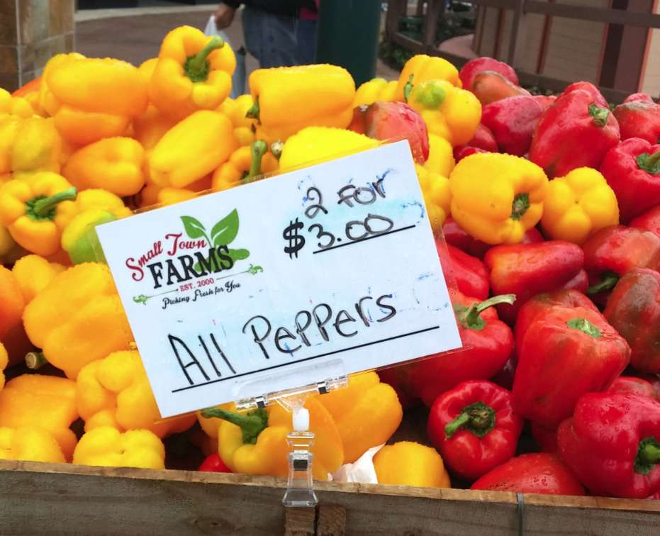 Produce at the Small Town Farms booth at the Shops at Wiregrass. Page Wyffels runs Small Town Farms, a vendor at a number of markets. (LAURA REILEY | Times)