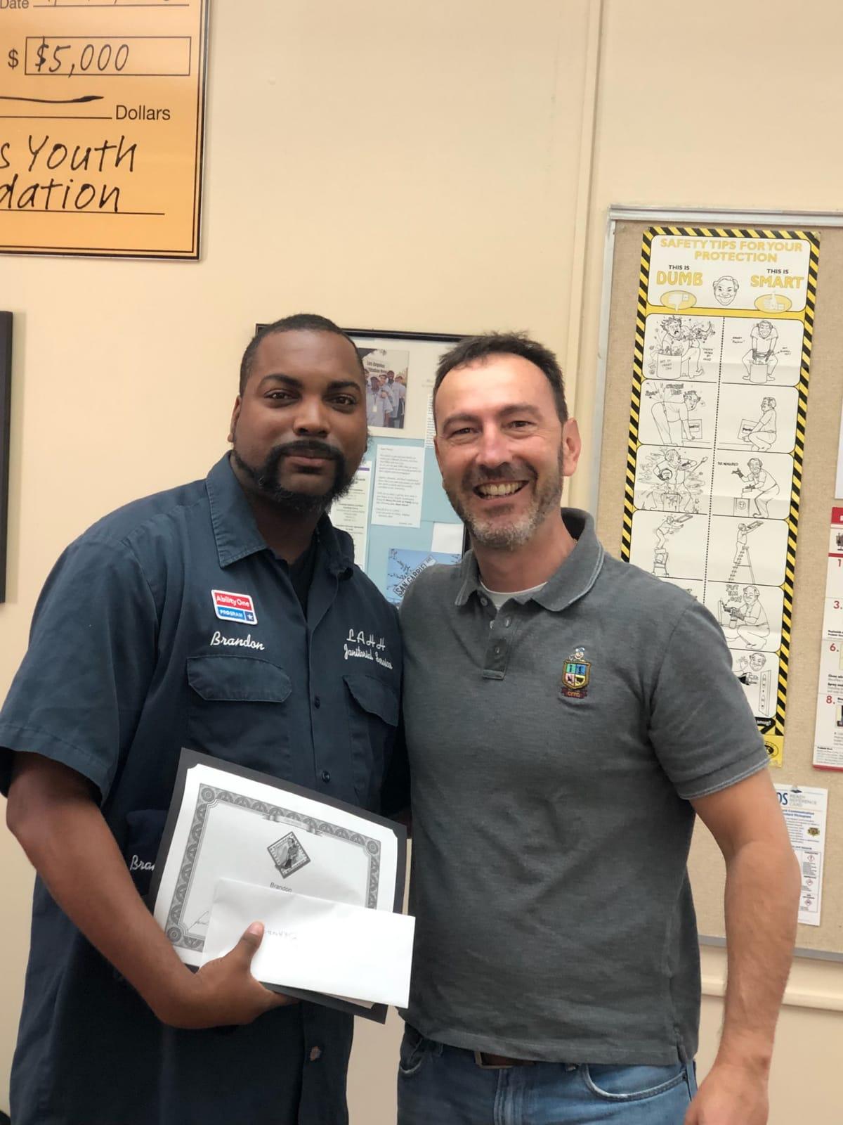 Brandon receives the Vacuum Specialist Certificate