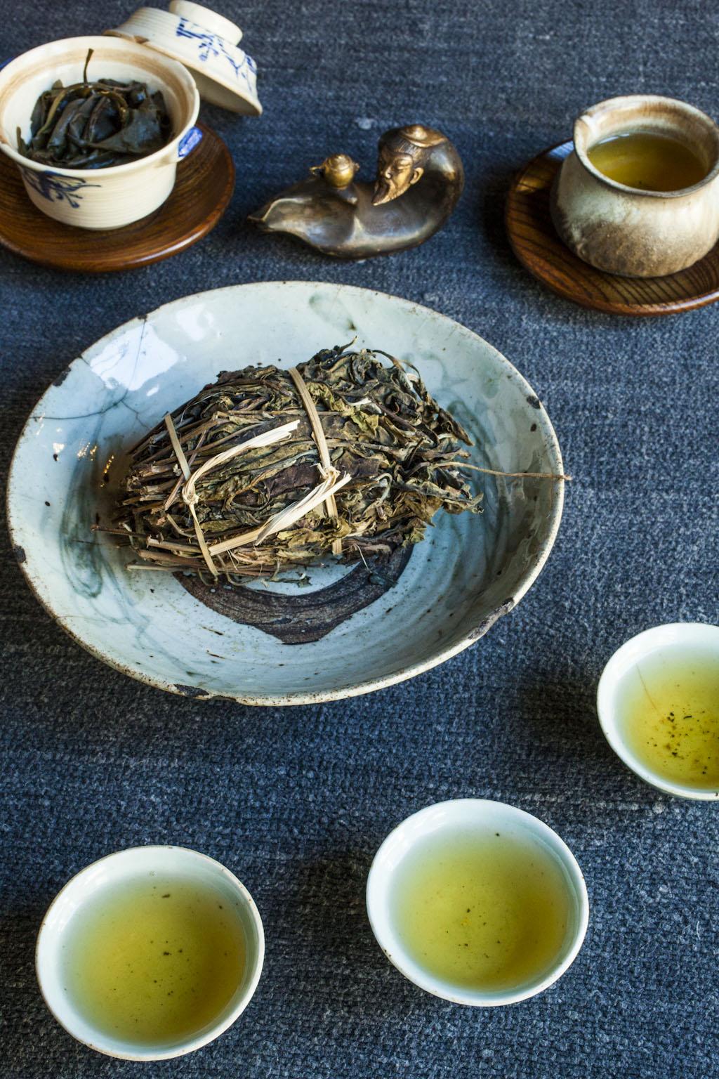 Japanese tea bowl (upper left), contemporary tea pitcher (upper right), Ming Dynasty plate (center), Ch'ing celadon tea cups (bottom)