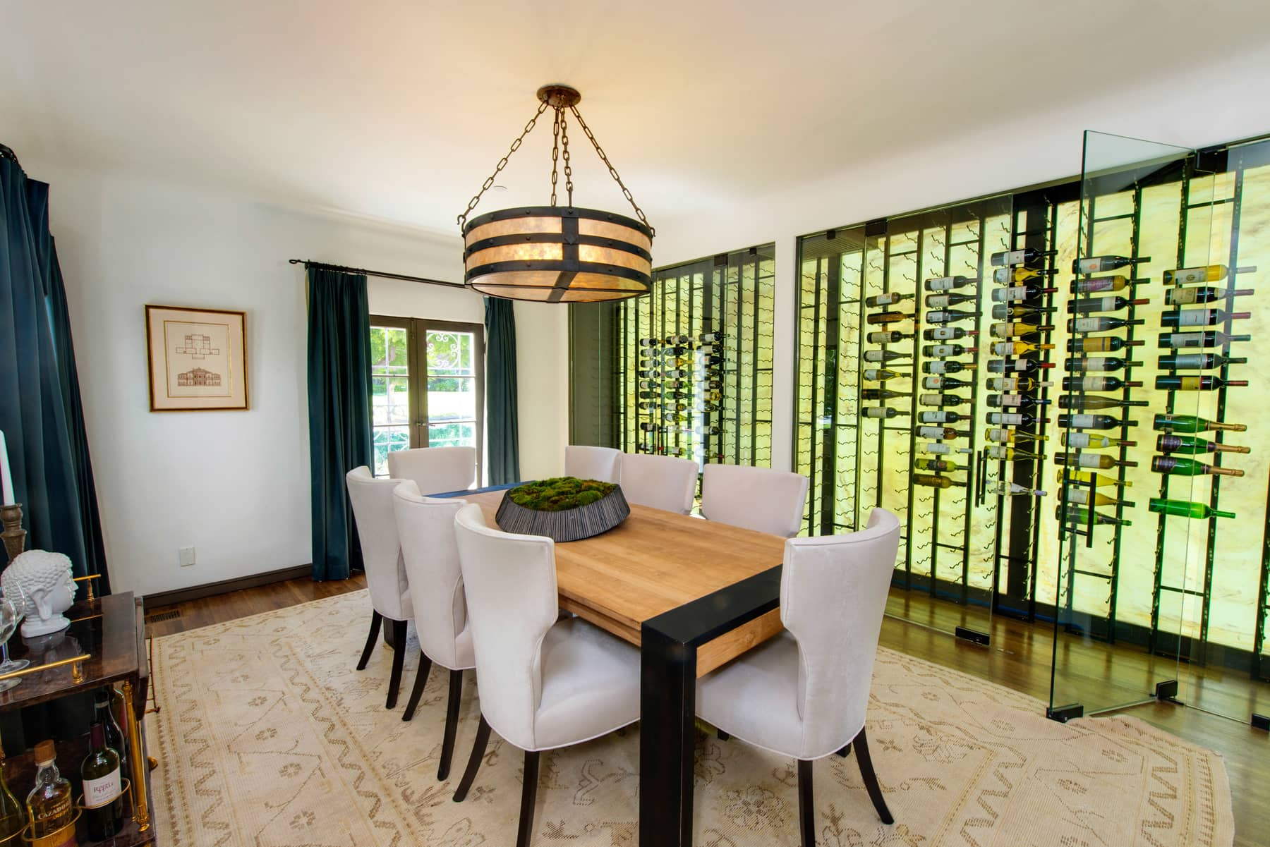 Dining room with wine wall by ZenHouse Collective