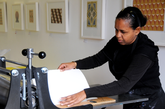 Helen printing in the studio, photo by Tamaryn Goodyear, 2012.