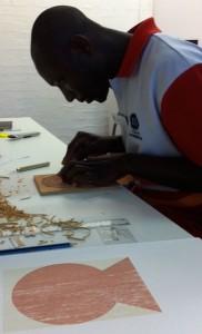 Sackey hard at work cutting his woodblock