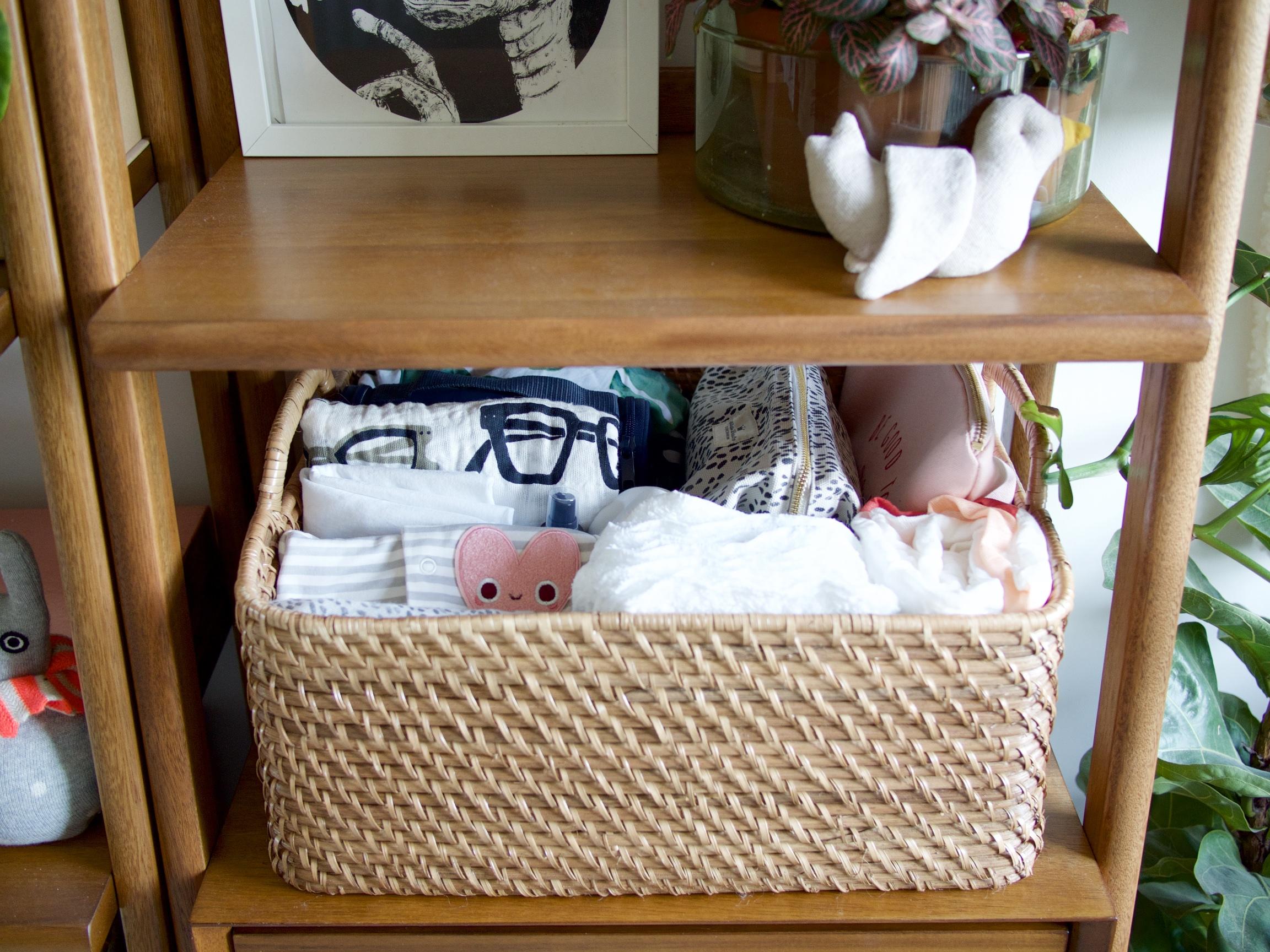 The Details: Linen bird rattle ;  woven basket *;  spectacles muslin ;  heart patch ;  spotty wash bag *