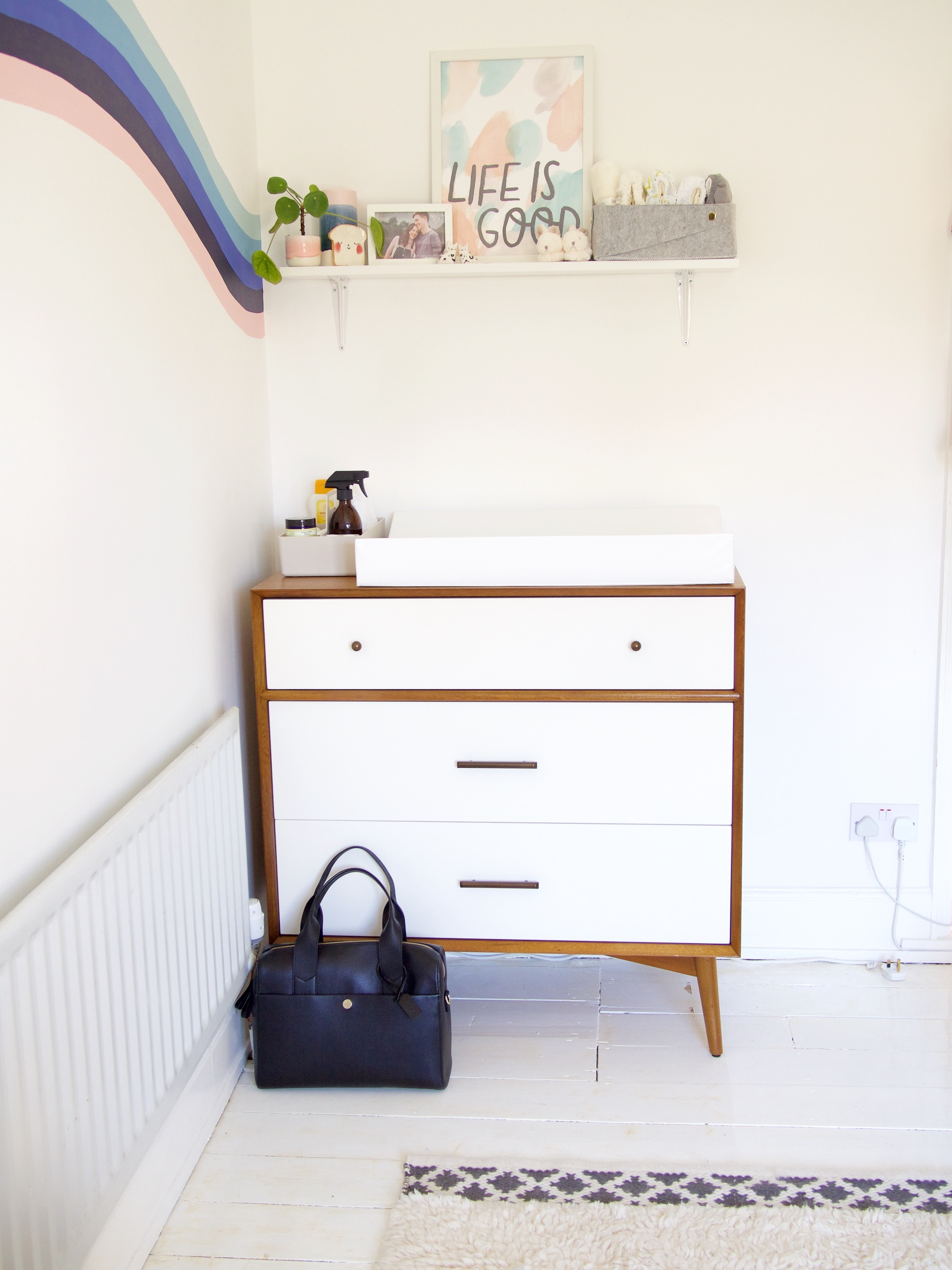 The details:  mid century dresser *;  changing bag *;  changing mat ;  amber spray bottle