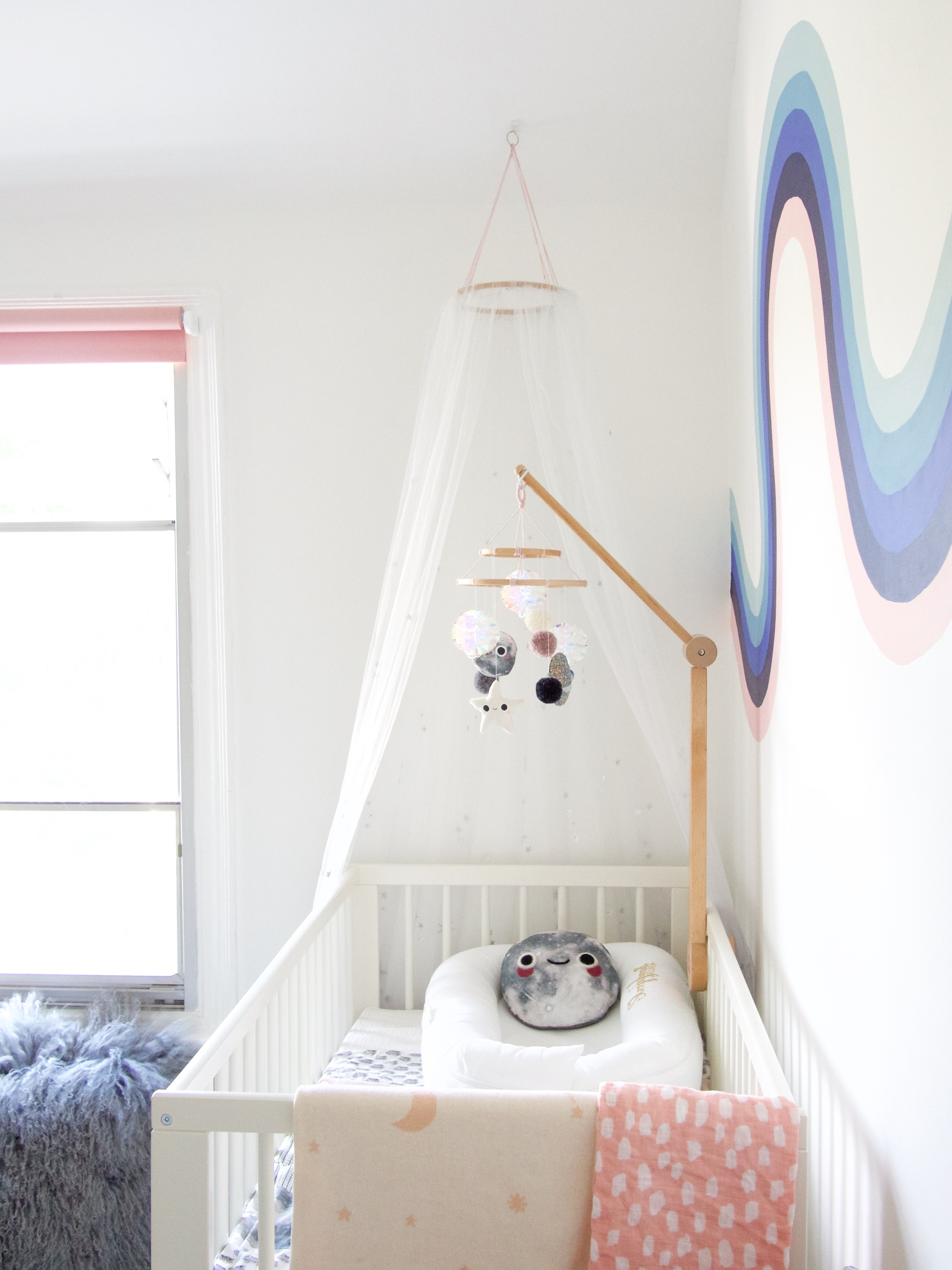 The Details: cot {old IKEA gulliver}; mobile {homemade};  mobile holder ; crib net {homemade from my  Crown & Glory wedding veil };  sleepyhead *; moon pillow {homemade}; fluffy cushion *;  moon & stars blanket ;  blush swaddle { UK stockist }
