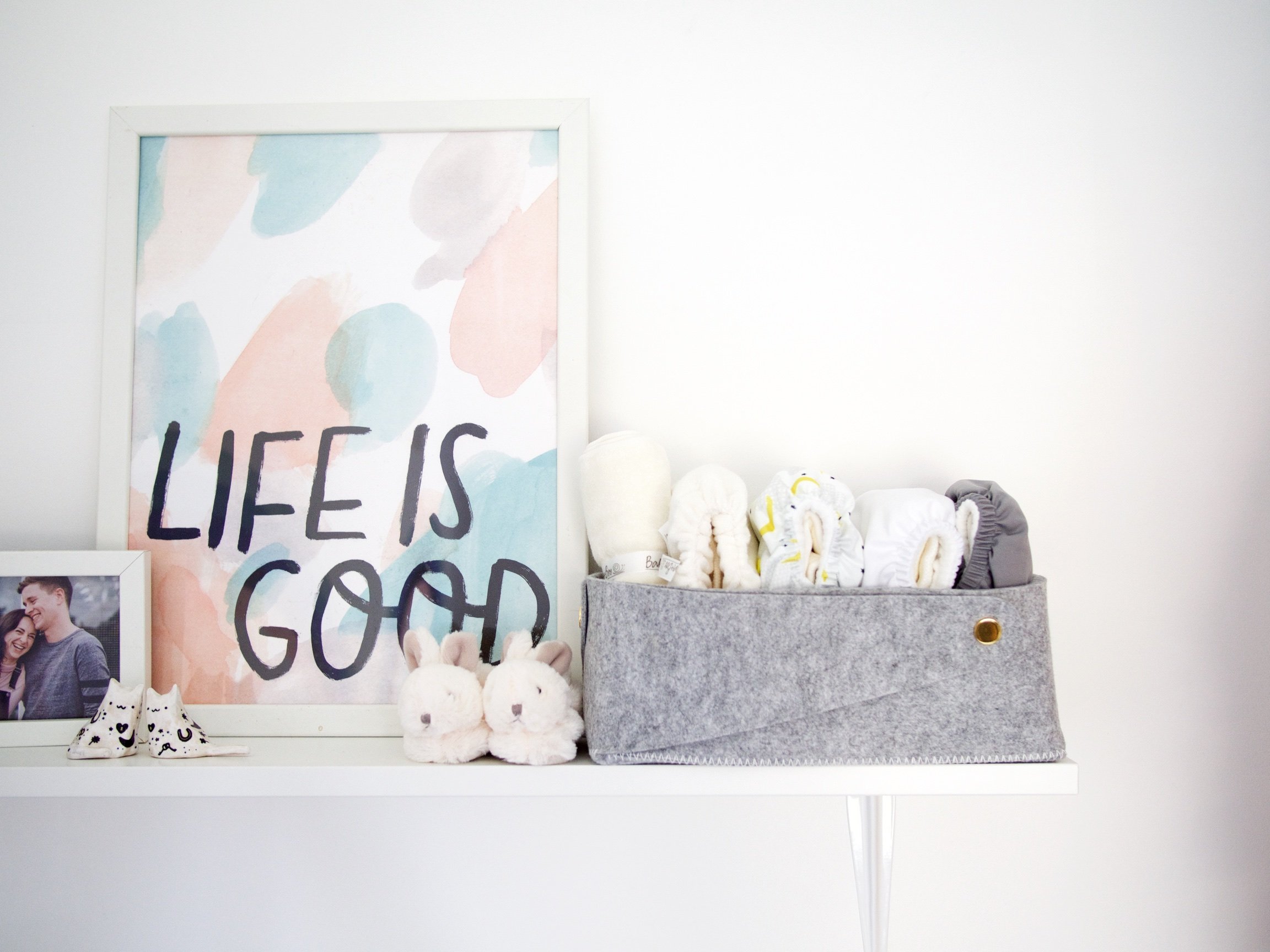 The Details:  life is good print ;  rabbit slippers ;  grey felt tub ;  cloth nappies *