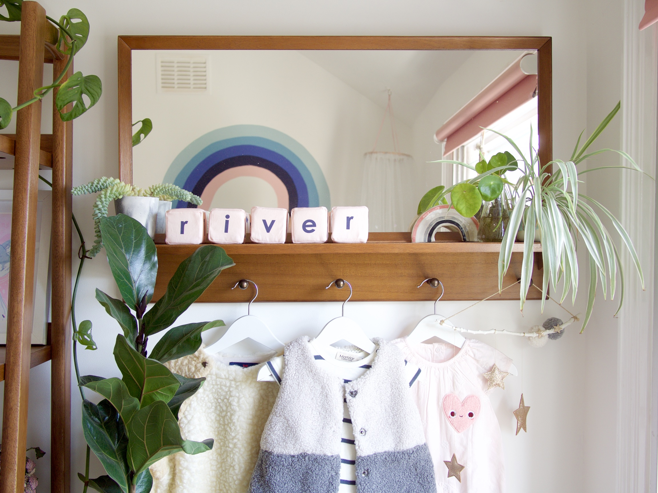The Details:  mirror *;  sensory name blocks ; ceramic rainbow {handmade by me!}; plants: pilia,spider plant & fiddle-leaf fig;  shearling all in one ;  striped romper ;  two-toned gilet ;  pink romper ;  heart patch ;  hanging decoration