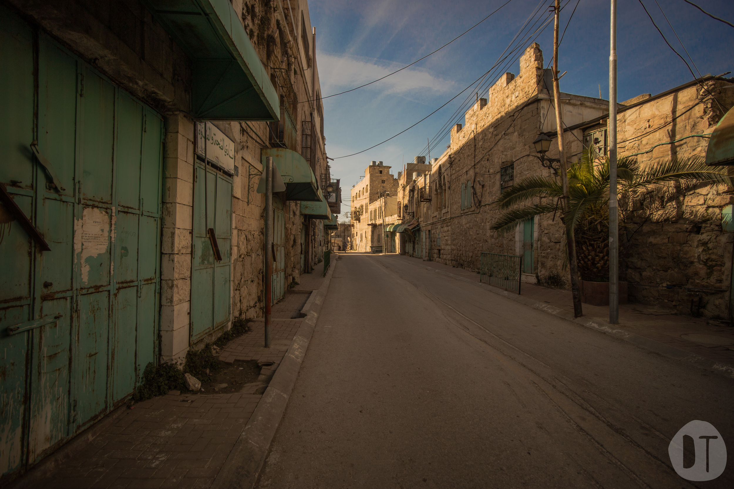 Al-Shuhada Street was once a thriving commercial street.Palestinian businesses were forced to close in 1994 and have since been sealed shut.