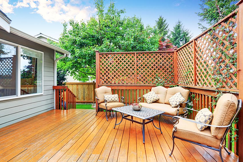 backyard-wood-deck-with-lattice-privacy-fence-and-outdoor-furniture.jpg