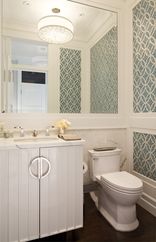BIGGER Mirror  This one is a no brainer if you want to make your small bathroom look bigger. Switching out your mirror for a bigger one will create more light in the space.