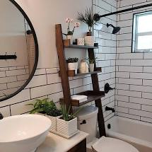 Simple Storage  Keep your storage units simple. Floating shelves and basic over-the-toilet ladder hutches keep the space open and clean.
