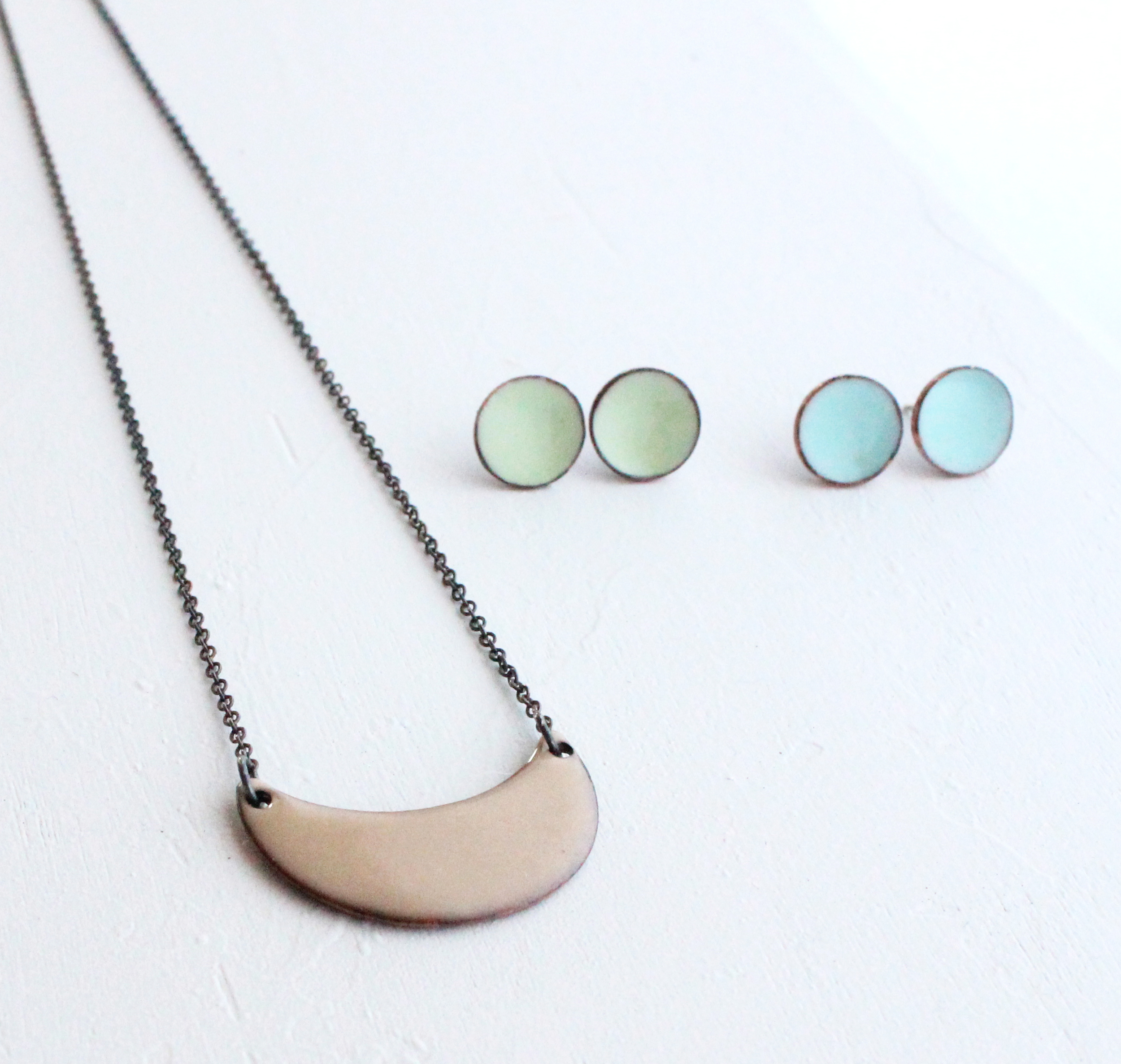This buff necklace pairs with anything. As do the light enamel post earrings. I wear my own pairs constantly.
