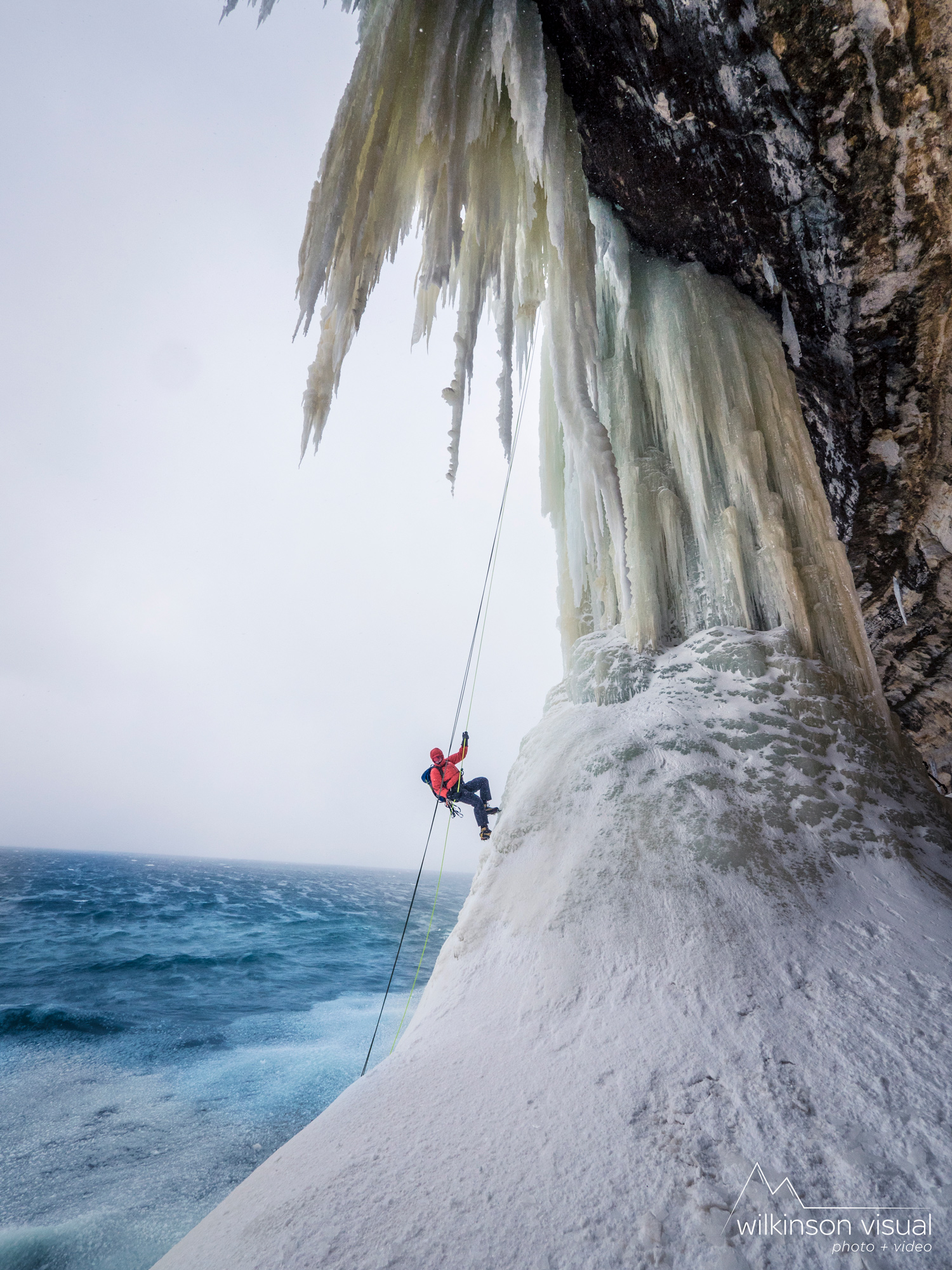 "Erik Olsen rappels down ""Dariyland"" along Lake Superior."