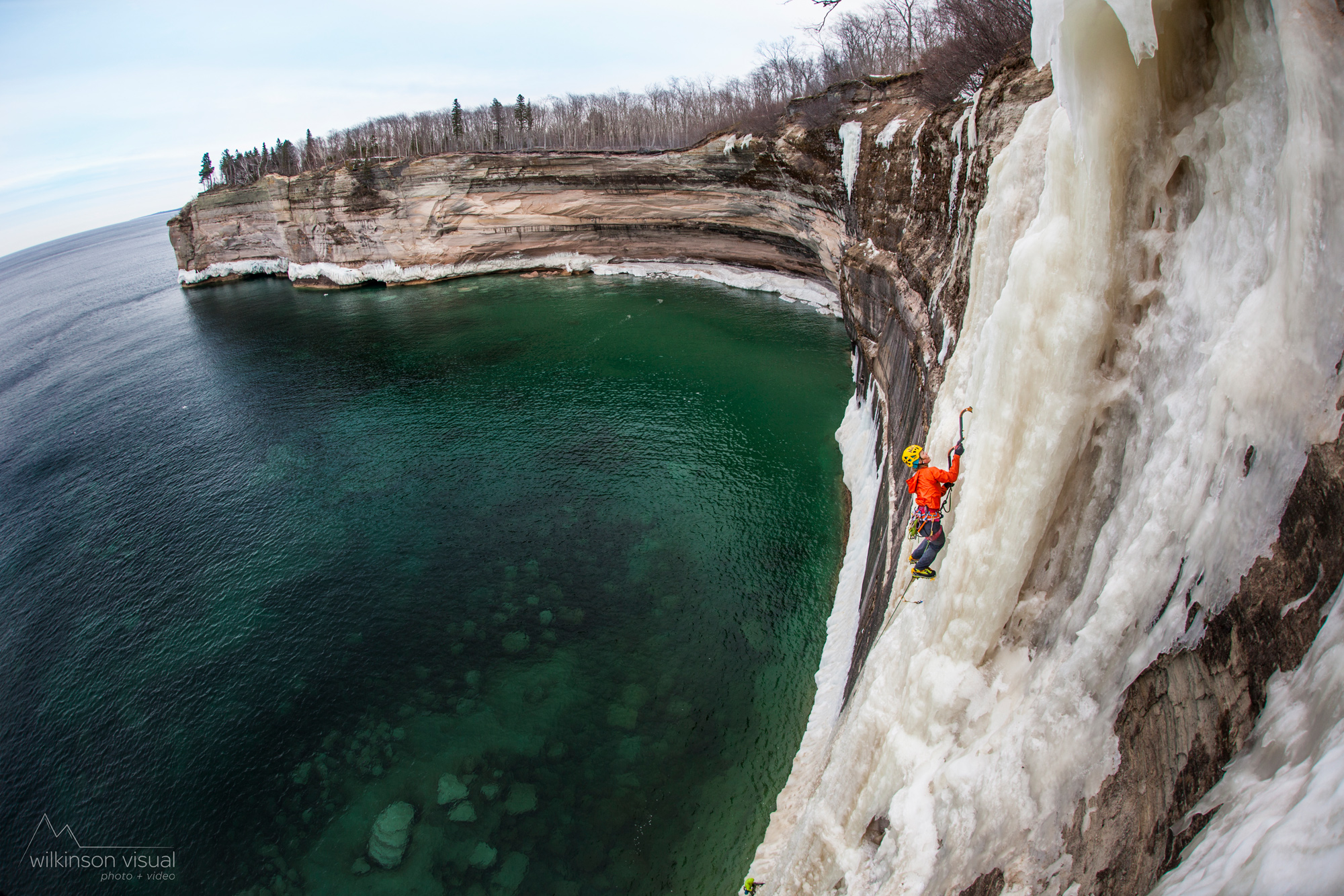 "Angela VanWiemeersch climbs ""HMR"" above Lake Superior in Northern Michigan."