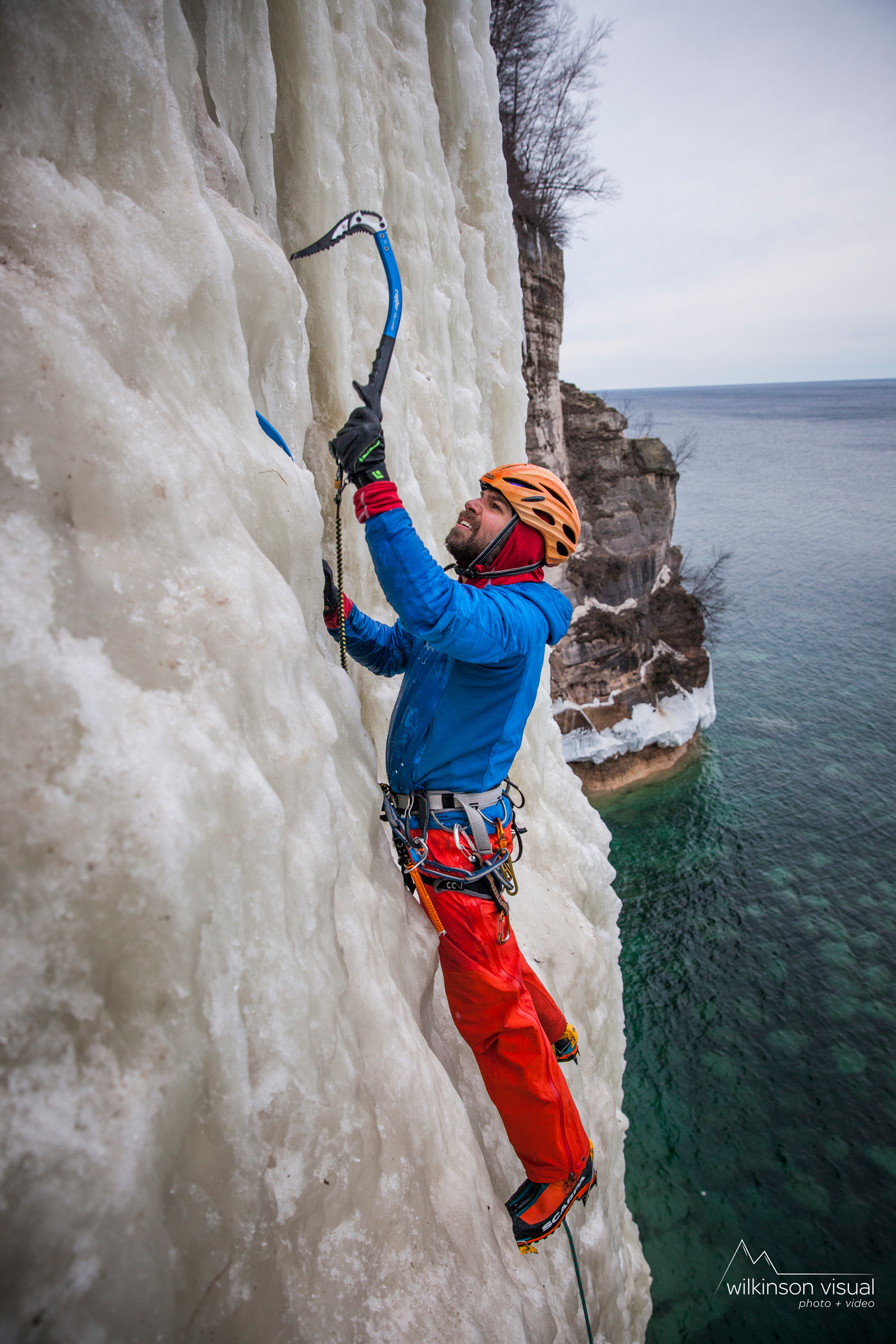 "Ari Novak climbs ""HMR"" above Lake Superior in Northern Michigan."