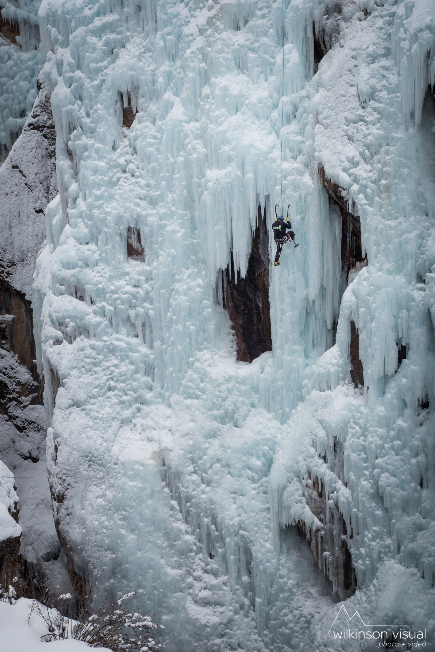 Amputee climber Jeff Bryan top ropes in the Ouray Ice park.
