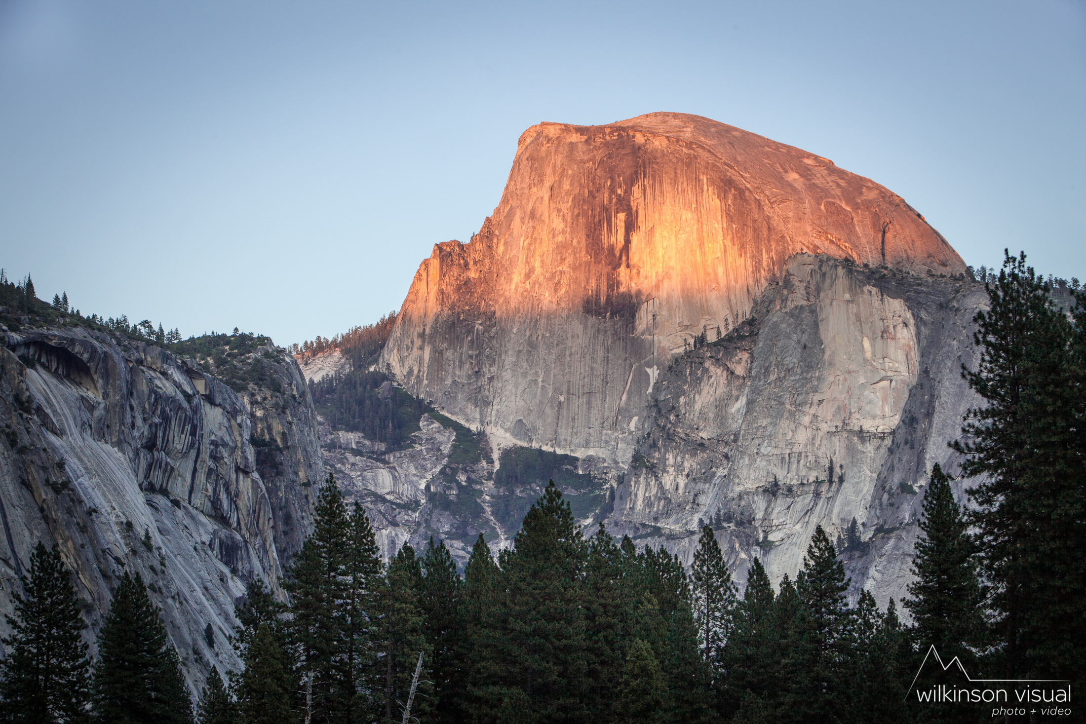 Yosemite's Half-Dome, catching the last light from sunset.