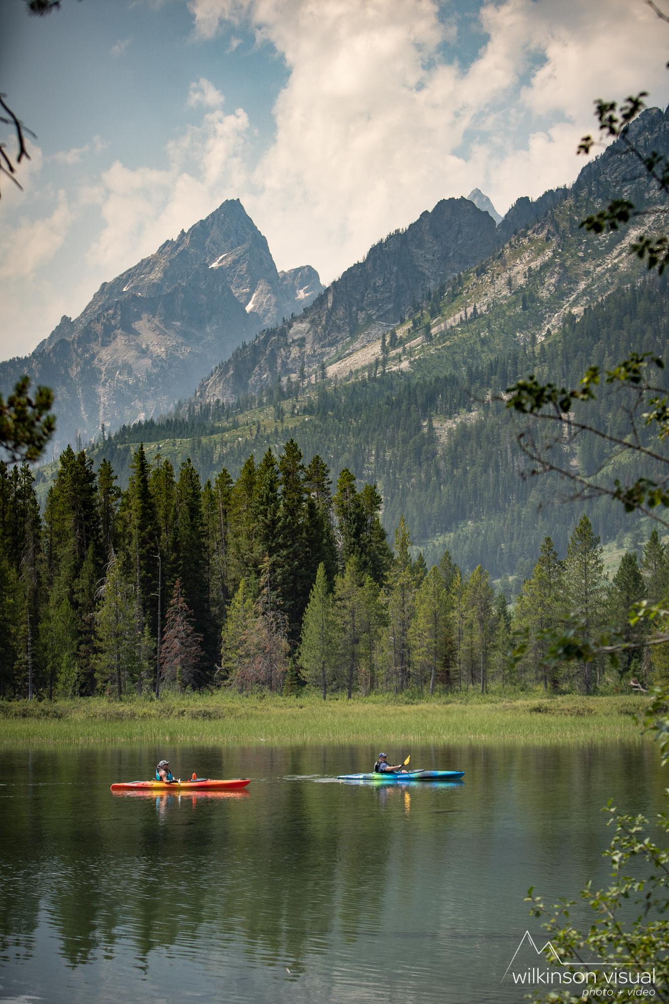 Kayakers paddle along String Lake in Grand Teton National Park.