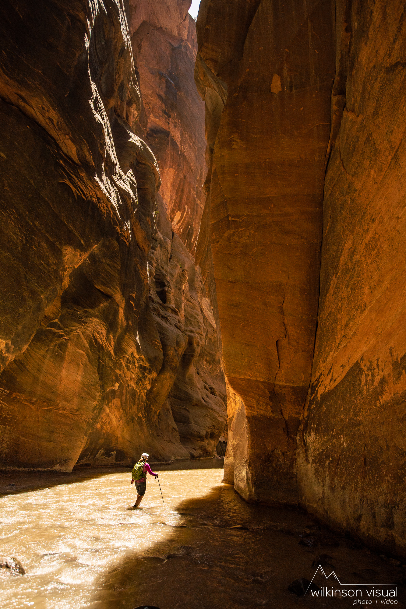Jen Meunier hikes through the narrows trail in Zion National Park.