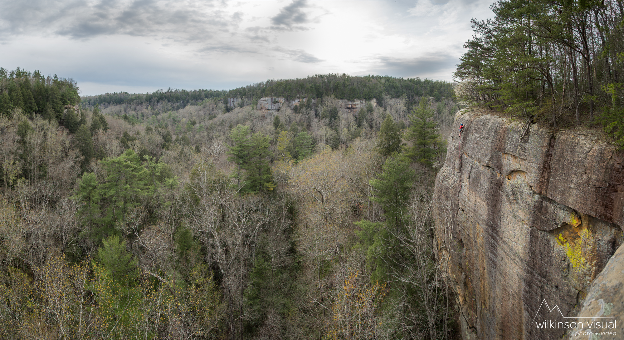 Panorama stitch of several high res images. Geoff Ris climbs a backcountry trad route deep in the Daniel Boone National Forest of Kentucky. Rope shown is Beal.