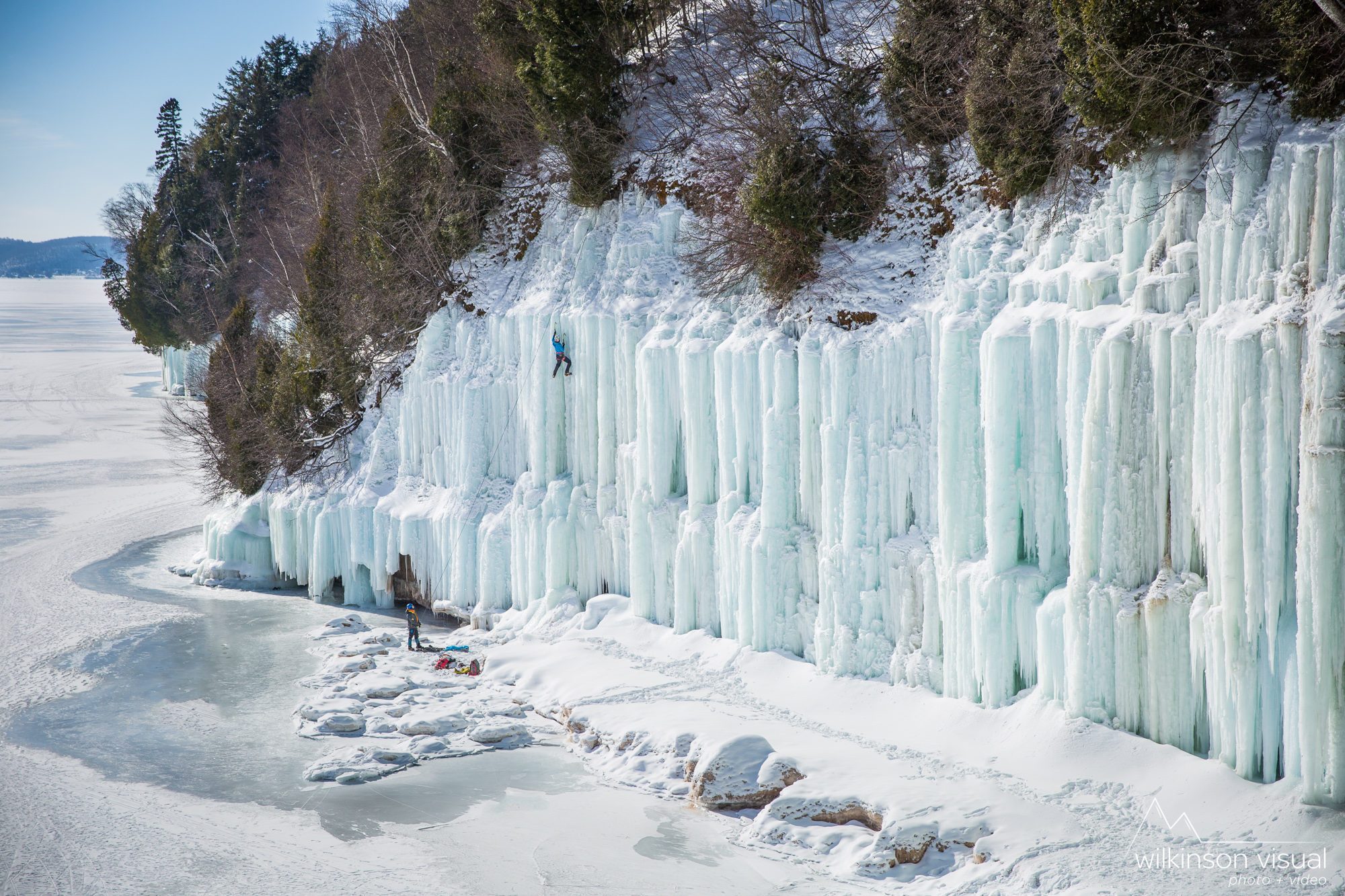 Ice climbers out on Grand Island, Michigan. Climbers shown are Nolan Amos and Kait Roszak.