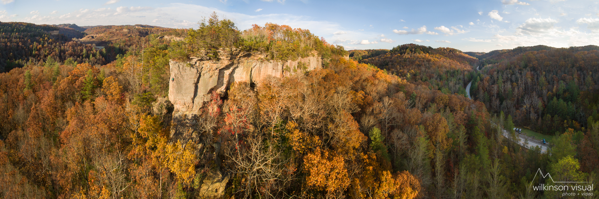 Panoramic photo stitch looking over the Emerald City climbing area in the Red River Gorge. Climber is Matt Hodges.