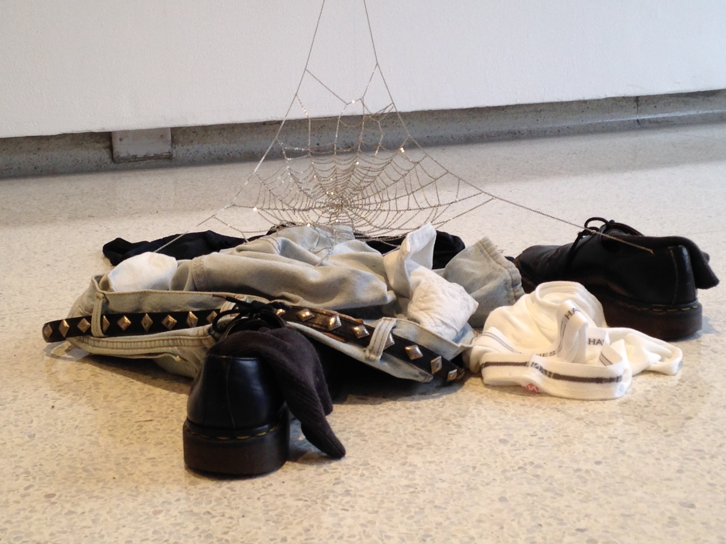 Jim Hodges  what's left  1992 white brass chain with clothing, dimensions variable