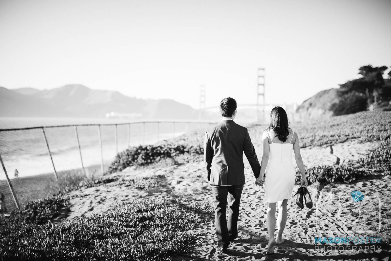 couple walking along baker beach, san francisco - engagement photography