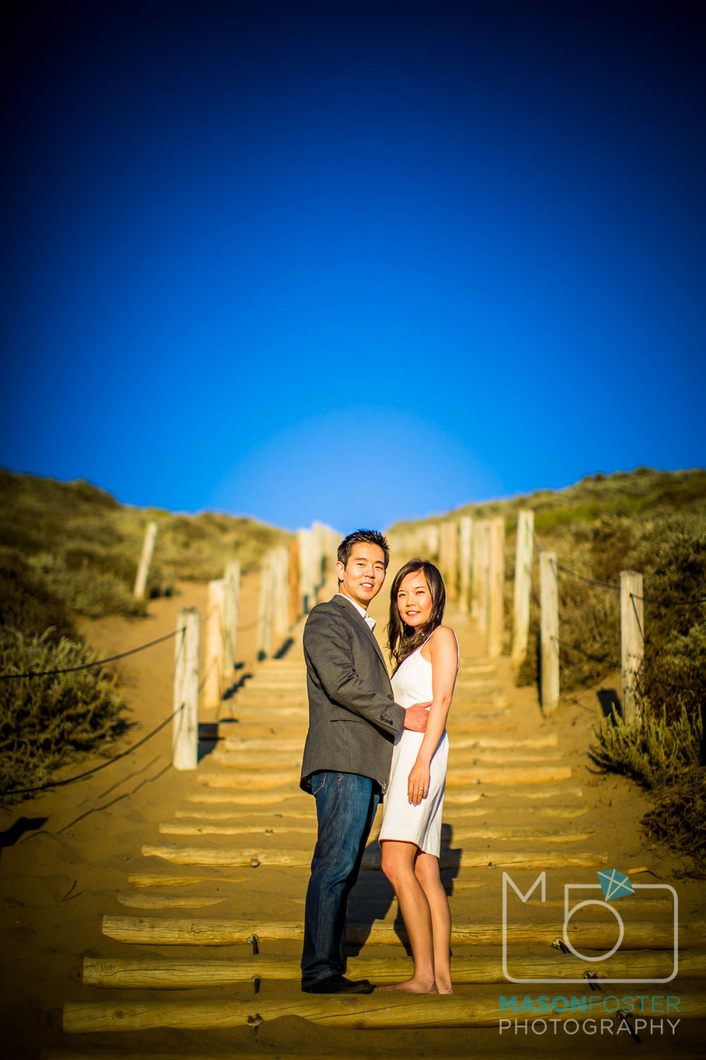 couple on staircase at baker beach, san francisco - engagement photography