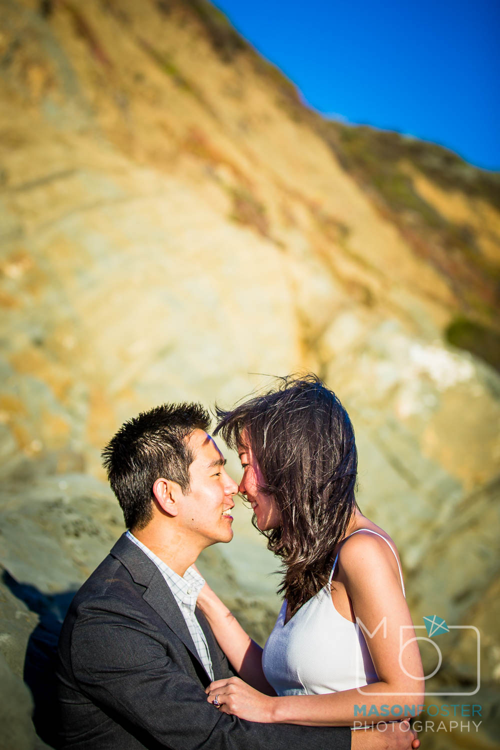 couple in the rocks at baker beach, san francisco - engagement photography