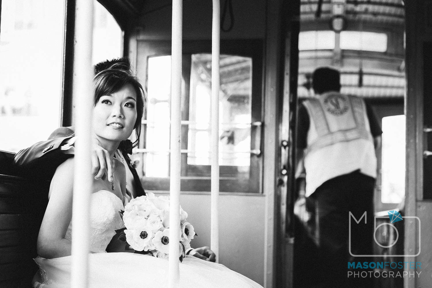 bride and groom on cable car , wedding photography at the westin st. francis in san francisco