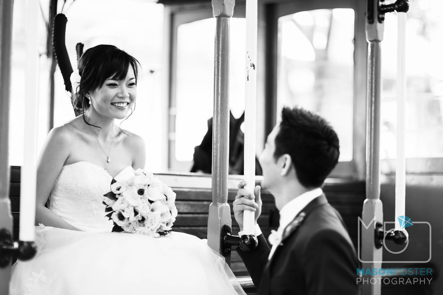 bride + groom on cable car , wedding photography at the westin st. francis in san francisco