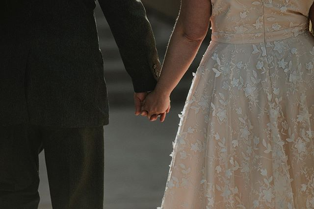 Beautiful unplanned moments... holding hands for the first time as husband and wife as they leave the ceremony.