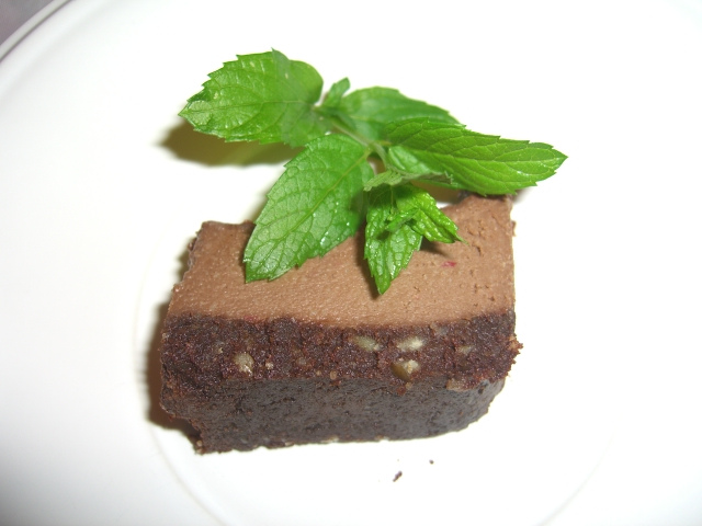Raw chocolate cake with mint leaves decoration